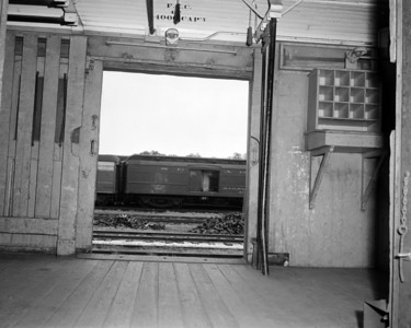 A close-up view of Floria East Coast Railway baggage car #437 at the FEC Bowden Yard in 1959.