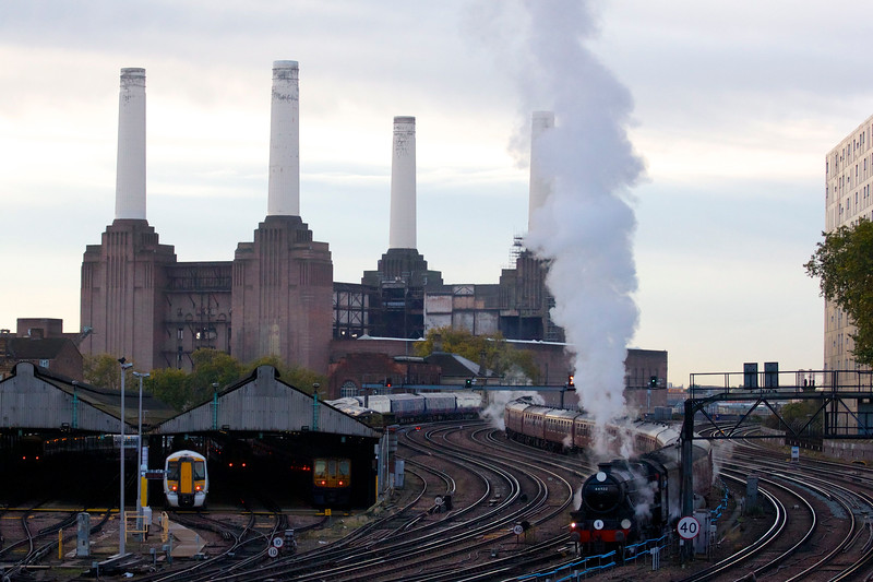 Two steam engines. One train. Putting the power back into Battersea Power Station. Arriving into London Victoria station at 8:13am on Saturday November 9 2013 to pick up passengers and then departing at 8:44am. <br /> <br /> LMS Class 5MT Black 5 44932 led the train into the station with 34046 Braunton then taking the lead to haul the charter service back out and up Grosvernor Bank towards the former Battersea Power station, helped by 44932 at the rear. A historic day return excursion to the Bluebell Railway in Sussex after the restoration of its link to the main line.