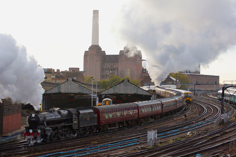 Two steam engines. One train. Putting the power back into Battersea Power Station. Arriving into London Victoria station at 8:13am on Saturday November 9 2013 to pick up passengers and then departing at 8:44am. <br /> <br /> LMS Class 5MT 44932 Black 5 led the train into the station with 34046 Braunton then taking the lead to haul the charter service back out and up Grosvernor Bank towards the former Battersea Power station, helped by 44932 at the rear. A historic day return excursion to the Bluebell Railway in Sussex after the restoration of its link to the main line.