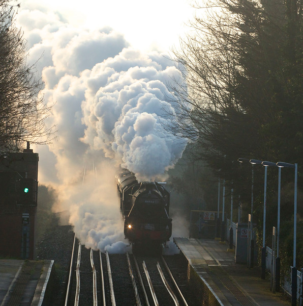 The Cathedrals Express hauled by Black 5 engine 44932 steams through Chiswick station at 07:41am on Saturday March 1 2014. A St David's Day return excursion from London Victoria to Cardiff.
