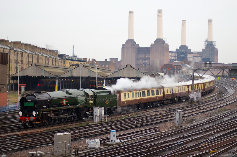 Clan Line hauls the British Pullman past Battersea Power Station and into London Victoria station.
