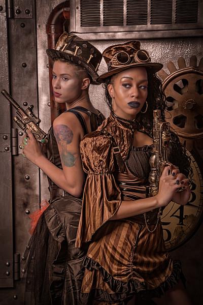 Steampunk ladies dress to defend