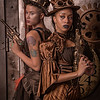 Steampunk ladies dress to defend