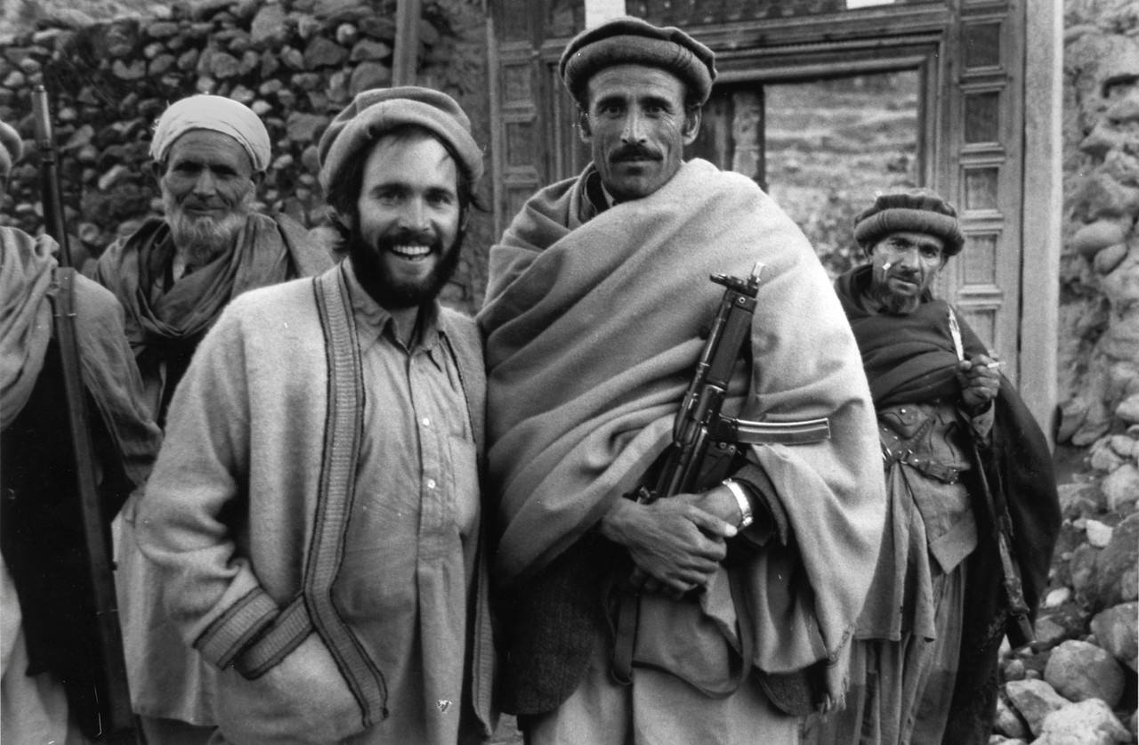 """<font size=""""3""""><font face=""""arial"""">Steve in Kunar Province, Afghanistan, 1979. McCurry lived among the people for 2 years at a time when westerners were prohibited from traveling there {much less takingf photojournalistic images).  He was forced to smuggle the photos he'd taken during that period out of the country by having the film canisters sewn into his garments prior to leaving.</font></font>"""