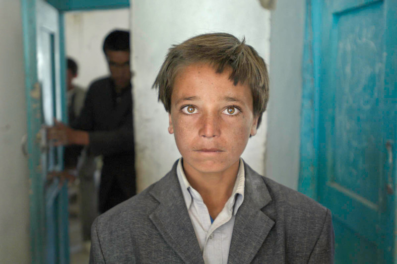 """<font size=""""3""""><font face=""""arial"""">His family is poor, his clothes used. But 15-year-old Ali Aqa isn't deterred: He plans to be a lawyer. Childhood memories include Taliban occupation of his village in Bamian. """"They burned everything, even my school,"""" he says. """"I pray to God no regime comes like that again."""" Bamian, Afghanistan. 2007"""