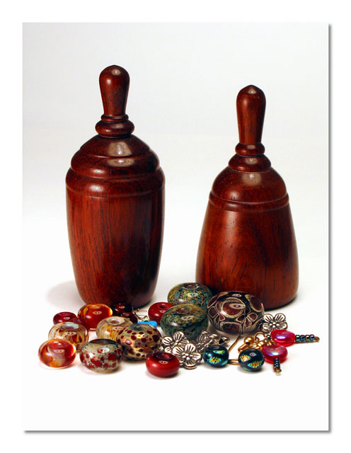 Turned rosewood boxes and glass beads.