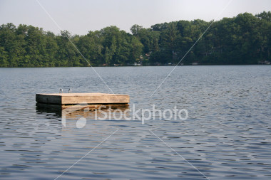 """<a href=""""http://www.istockphoto.com/file_closeup/object/1337434.php?id=1337434&refnum=jwilkinson"""" target=""""istock"""">swimming and diving platform 2</a><br>floating swimming and diving platform on small lake or pond"""