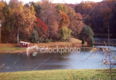 "<a href=""http://www.istockphoto.com/file_closeup/object/31815.php?id=31815&refnum=jwilkinson"" target=""istock"">Boat house and fall colors</a><br>a small boat house on a farm pond/lake surrounded by trees showing fall colors. <br><br>Please drop me a note if/where you use it. (no restrictions, I'm just curious about how people are using it)"