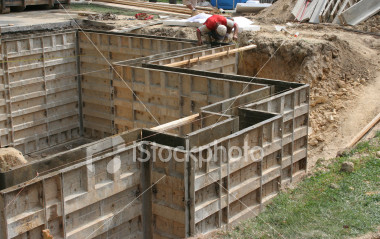 "<a href=""http://www.istockphoto.com/file_closeup/object/1974630.php?id=1974630&refnum=jwilkinson"" target=""istock"">Wall forms / molds for concrete</a><br>A construction worker checking the measurements of steel forms set up making a mold, ready for concrete to be poured for the walls of a basement room, seen in the dirt excavation hole. <br><br>One of a series, following this construction project.<br><br>See also: <br><a href=http://www.istockphoto.com/file_closeup.php?id=1930705><img border=0 src='http://www.istockphoto.com/file_thumbview_approve.php?size=1&id=1930705'></a> <a href=http://www.istockphoto.com/file_closeup.php?id=1930738><img border=0 src='http://www.istockphoto.com/file_thumbview_approve.php?size=1&id=1930738'></a> <a href=http://www.istockphoto.com/file_closeup.php?id=1930752><img border=0 src='http://www.istockphoto.com/file_thumbview_approve.php?size=1&id=1930752'></a> <a href=http://www.istockphoto.com/file_closeup.php?id=1930772><img border=0 src='http://www.istockphoto.com/file_thumbview_approve.php?size=1&id=1930772'></a> <a href=http://www.istockphoto.com/file_closeup.php?id=1974596><img border=0 src='http://www.istockphoto.com/file_thumbview_approve.php?size=1&id=1974596'></a>  <br>"