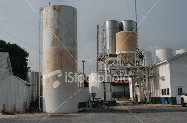 "<a href=""http://www.istockphoto.com/file_closeup/object/2196530.php?id=2196530&refnum=jwilkinson"" target=""istock"">Liquid loading station for trucks</a><br>a pull-through setup for loading liquids onto trucks.  various tanks, full station view with large tank and buildings.<br><br>See also: <br><a href=http://www.istockphoto.com/file_closeup.php?id=2196492><img border=0 src='http://www.istockphoto.com/file_thumbview_approve.php?size=1&id=2196492'></a><br>"