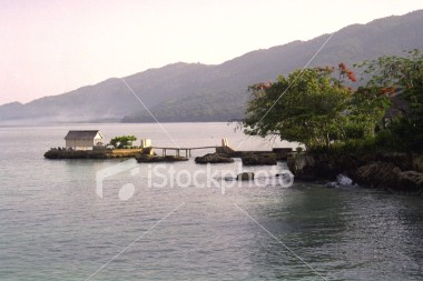 "<a href=""http://www.istockphoto.com/file_closeup/object/29727.php?id=29727&refnum=jwilkinson"" target=""istock"">home off coast of jamaica</a><br>a home (?) off south coast of jamaica, out in water, attached by foot bridge.  <br>Please drop me a note if/where you use it."