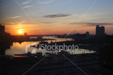 "<a href=""http://www.istockphoto.com/file_closeup/object/1794205.php?id=1794205&refnum=jwilkinson"" target=""istock"">Baltimore Inner Harbor Sunset 2</a><br>a view of the Baltimore Inner Harbor during an intense sunset, facing west, over marinas and docks.  The point of view is high since it was taken from 11th floor of the Sheraton.<br><br><b>See also the vertically-formatted version:</b><br><a href=http://www.istockphoto.com/file_closeup.php?id=1417982><img border=0 src='http://www.istockphoto.com/file_thumbview_approve.php?size=1&id=1417982'></a><br><br>Note that there is a lot of detail even in the darker sections of marina, walks, etc, even though it doesn't show up in the istockphoto preview."