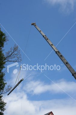 """<a href=""""http://www.istockphoto.com/file_closeup/object/3174952.php?id=3174952&refnum=jwilkinson"""" target=""""istock"""">Building the Church 2</a><br>a crane lifts a steel beam up over part of a church as part of construction, shown against a beautiful bold blue sky with a few clouds to make it interesting. Only a tip of the roof if the building below shows in this shot.<br><br>Themes of 'building the church' (people as well as structures, bringing people to God, building the church community).  Also useful for general construction themes."""
