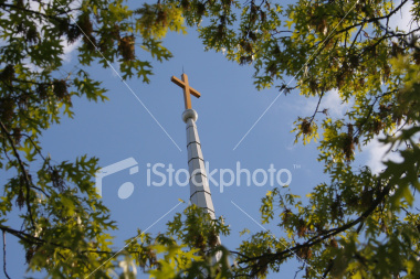 "<a href=""http://www.istockphoto.com/file_closeup/object/3352023.php?id=3352023&refnum=jwilkinson"" target=""istock"">Cross on steeple framed by trees</a><br>A cross tops a traditional-style church steeple, both framed by tree branches against a<br>brilliant blue sky with some gentle white clouds.  <br><br>Focus is on the cross and steeple.<br>Note: a wider, uncropped original is available upon request.<br>Please use respectfully.<br><br>See also:<br><a href=http://www.istockphoto.com/file_closeup.php?id=3352073><img border=0 src='http://www.istockphoto.com/file_thumbview_approve.php?size=1&id=3352073'></a> <a href=http://www.istockphoto.com/file_closeup.php?id=3351959><img border=0 src='http://www.istockphoto.com/file_thumbview_approve.php?size=1&id=3351959'></a> <a href=http://www.istockphoto.com/file_closeup.php?id=3352133><img border=0 src='http://www.istockphoto.com/file_thumbview_approve.php?size=1&id=3352133'></a> <a href=http://www.istockphoto.com/file_closeup.php?id=3433271><img border=0 src='http://www.istockphoto.com/file_thumbview_approve.php?size=1&id=3433271'></a> <br>"