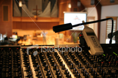 "<a href=""http://www.istockphoto.com/file_closeup/object/2191493.php?id=2191493&refnum=jwilkinson"" target=""istock"">Running sound at a church worship service</a><br>Peaceful view of a church sanctuary and worship service in soft focus behind a view of a sound/audio mixing board (console) and sound level meter.  Projection screen and speaker/preacher in background, with organ pipes and cross showing that it is a church.<br><br>Concepts can include: running sound at church, the technical support behind services, the use of new technology in worship services & churches, etc.<br><br>(Horizontal view with sound level meter to the right. See portfolio for several similar shots)<br><br>See also: <br><a href=http://www.istockphoto.com/file_closeup.php?id=2191644><img border=0 src='http://www.istockphoto.com/file_thumbview_approve.php?size=1&id=2191644'></a> <a href=http://www.istockphoto.com/file_closeup.php?id=3685085><img border=0 src='http://www.istockphoto.com/file_thumbview_approve.php?size=1&id=3685085'></a> <a href=http://www.istockphoto.com/file_closeup.php?id=4551255><img border=0 src='http://www.istockphoto.com/file_thumbview_approve.php?size=1&id=4551255'></a> <br><br>"