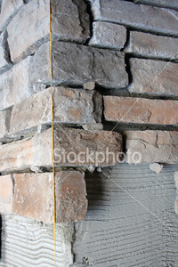 <a href=http://www.istockphoto.com/file_closeup/object/5686633.php?id=5686633&refnum=jwilkinson target=istock>Stone Work - Column</a><br>partially-completed stonework layer or facade construction on a column.  Plumb line is shown, mortar has not yet been added between the stones.<br><br>See also:<br><a href=http://www.istockphoto.com/file_closeup.php?refnum=jwilkinson&id=5686701><img border=0 src=http://www.istockphoto.com/file_thumbview_approve.php?refnum=jwilkinson&size=1&id=5686701></a> <br><br>