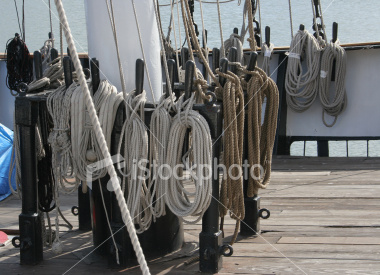 """<a href=""""http://www.istockphoto.com/file_closeup/object/1796485.php?id=1796485&refnum=jwilkinson"""" target=""""istock"""">Coiled, cleated lines on a tall ship</a><br>coils of rope on old-fashioned cleats at the base of the mast on the tall ship Clipper City, which docks in the Baltimore inner harbor."""