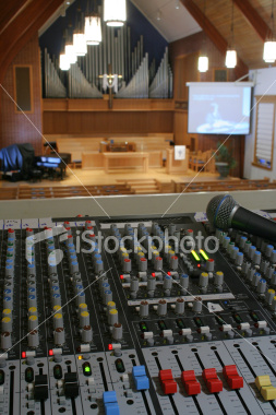 "<a href=""http://www.istockphoto.com/file_closeup/object/4551255.php?id=4551255&refnum=jwilkinson"" target=""istock"">Running sound at a church worship service</a><br>Peaceful view of a church sanctuary in slightly soft focus behind a view of a sound/audio mixing board (console) and microphone.  Projection screen in background, with organ pipes and cross showing that it is a church. very sharp focus on the nearest sound board controls, with the service blurred by depth of field, though the center of the composition is the service & cross, not the tech. <br><br>Lighting is purposely brighter towards the front of the church vs that on the sound board, to emphasize the focus and purpose being there, not on the tech. <br><br>Concepts can include: running sound at church, the technical support behind services, the use of new technology in worship services & churches, etc. <br><br>See other photos in this series:<br><a href=http://www.istockphoto.com/file_closeup.php?id=3685085&refnum=jwilkinson><img border=0 src='http://www.istockphoto.com/file_thumbview_approve.php?size=1&id=3685085'></a> <a href=http://www.istockphoto.com/file_closeup.php?id=2191644&refnum=jwilkinson><img border=0 src='http://www.istockphoto.com/file_thumbview_approve.php?size=1&id=2191644'></a> <a href=http://www.istockphoto.com/file_closeup.php?id=2191493&refnum=jwilkinson><img border=0 src='http://www.istockphoto.com/file_thumbview_approve.php?size=1&id=2191493'></a><br><br>"