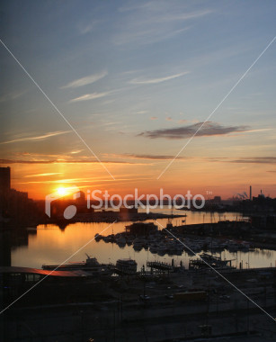 "<a href=""http://www.istockphoto.com/file_closeup/object/1417982.php?id=1417982&refnum=jwilkinson"" target=""istock"">Baltimore Inner Harbor Sunset</a><br>a vertical view of the Baltimore Inner Harbor during an intense sunset, facing west, over marinas and docks.  The point of view is high since it was taken from 11th floor of the Sheraton.<br><br><b>See also the horizontally-formatted version:</b><br><a href=http://www.istockphoto.com/file_closeup.php?id=1794205><img border=0 src='http://www.istockphoto.com/file_thumbview_approve.php?size=1&id=1794205'></a><br><br>Note that there is a lot of detail even in the darker sections of marina, walks, etc, even though it doesn't show up in the istockphoto preview."