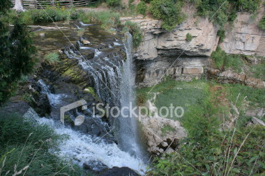 "<a href=""http://www.istockphoto.com/file_closeup/object/2188238.php?id=2188238&refnum=jwilkinson"" target=""istock"">Websters Falls</a><br>a view from above as a large waterfall drops into its lower valley.  This is Websters Falls, Hamilton, Ontario, Canada"