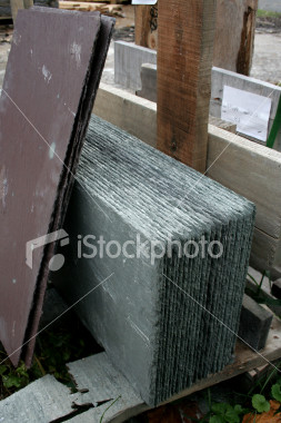 "<a href=""http://www.istockphoto.com/file_closeup/object/2407149.php?id=2407149&refnum=jwilkinson"" target=""istock"">Slates ready for roofing</a><br>a stack of purple and grey roofing slates (slate shingles) in a wooden slatted crate ready to be installed on a roof. <br><br>See also: <br><a href=http://www.istockphoto.com/file_closeup.php?id=2407088><img border=0 src='http://www.istockphoto.com/file_thumbview_approve.php?size=1&id=2407088'></a> <a href=http://www.istockphoto.com/file_closeup.php?id=2629368><img border=0 src='http://www.istockphoto.com/file_thumbview_approve.php?size=1&id=2629368'></a> <br>"