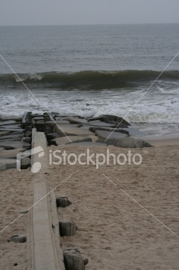 "<a href=""http://www.istockphoto.com/file_closeup/object/1310662.php?id=1310662&refnum=jwilkinson"" target=""istock"">beach break water</a><br>break water or piling and rock break to prevent surf rip currents, from Bethany Beach Delaware (what's this called?), cold, fall day, gray sky"