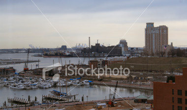 """<a href=""""http://www.istockphoto.com/file_closeup/object/1794280.php?id=1794280&refnum=jwilkinson"""" target=""""istock"""">Baltimore Inner Harbor South-West 1</a><br>grey-day view of the Baltimore Inner Harbor facing southwest, over marinas, docks, including Federal Hill and the old Domino Sugar plant with port cranes in the distance.<br><br>Taken on a gray winter day, showing the contrast between the bright pleasure boats in the center and the gray sky and industrial plants, cranes and construction in the background and foreground.<br><br>The point of view is high since it was taken from 11th floor of the Sheraton.<br><br>See also: <br><a href=http://www.istockphoto.com/file_closeup.php?id=1974362><img border=0 src='http://www.istockphoto.com/file_thumbview_approve.php?size=1&id=1974362'></a> <a href=http://www.istockphoto.com/file_closeup.php?id=1930576><img border=0 src='http://www.istockphoto.com/file_thumbview_approve.php?size=1&id=1930576'></a> <a href=http://www.istockphoto.com/file_closeup.php?id=2263838><img border=0 src='http://www.istockphoto.com/file_thumbview_approve.php?size=1&id=2263838'></a> <br><a href=http://www.istockphoto.com/file_closeup.php?id=2299564><img border=0 src='http://www.istockphoto.com/file_thumbview_approve.php?size=1&id=2299564'></a> <a href=http://www.istockphoto.com/file_closeup.php?id=1844922><img border=0 src='http://www.istockphoto.com/file_thumbview_approve.php?size=1&id=1844922'></a> <a href=http://www.istockphoto.com/file_closeup.php?id=1974305><img border=0 src='http://www.istockphoto.com/file_thumbview_approve.php?size=1&id=1974305'></a> <br><a href=http://www.istockphoto.com/file_closeup.php?id=1844939><img border=0 src='http://www.istockphoto.com/file_thumbview_approve.php?size=1&id=1844939'></a> <br>"""