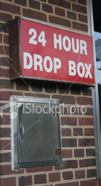 """<a href=""""http://www.istockphoto.com/file_closeup/object/4669671.php?id=4669671&refnum=jwilkinson"""" target=""""istock"""">Drop Box</a><br>24 hour drop box sign and steel dropbox door in brick wall at a Laundry, Laundromat<br><br>Could be used for other businesses as well of course since it doesn't say anything specific to laundry"""