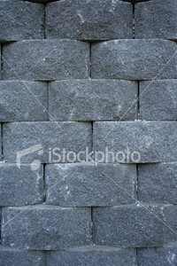 "<a href=""http://www.istockphoto.com/file_closeup/object/3481805.php?id=3481805&refnum=jwilkinson"" target=""istock"">Stone block wall</a><br>chamfered gray stones blocks forming a wall"