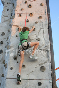 "<a href=""http://www.istockphoto.com/file_closeup/object/4550507.php?id=4550507&refnum=jwilkinson"" target=""istock"">Climbing wall girl</a><br>a teenage girl scales a climbing wall at a fair. setting is near dusk.  <br><br>See also:<br><a href=http://www.istockphoto.com/file_closeup.php?id=4550525&refnum=jwilkinson><img border=0 src='http://www.istockphoto.com/file_thumbview_approve.php?size=1&id=4550525'></a> <br>"