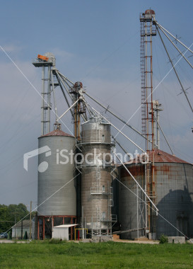 "<a href=""http://www.istockphoto.com/file_closeup/object/2387194.php?id=2387194&refnum=jwilkinson"" target=""istock"">Agri-business silo cluster</a><br>a cluster of farm silos or grain elevators, laced with ladders, a spiral catwalk, etc.  Taken on the eastern shore area of Maryland."
