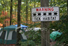 "<a href=""http://www.istockphoto.com/file_closeup/object/4550544.php?id=4550544&refnum=jwilkinson"" target=""istock"">Tick Habitat - Hazards of Camping</a><br>a sign warns about tick habitat at a campground, with camping tents in the background in the midst of sunlit, colorful autumn forest.<br><br>photo has plenty of margin for lightening to suit your preferences or needs"