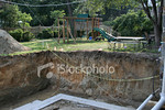 """<a href=""""http://www.istockphoto.com/file_closeup/object/1930752.php?id=1930752&refnum=jwilkinson"""" target=""""istock"""">Hole in a yard</a><br>looking up out of a large construction hole for a basement addition next to a green yard and home playset / swingset.<br><br>strong & abrupt visual fall-off from the nice family playset and green yard into the rough deep hole. <br><br>Themes can include: home improvement excavation, construction safety, safety at home, child safety, etc.<br><br>Or deeper themes such as how easy it is to go from a typical life(style) into various kinds of personal calamities (homelessness, financial debt, emotional problems...)<br><br>Themes could include: family financial debt, bankrupcy, emotional depression, down, in a hole, in a real mess, trapped, stuck, overwhelmed with problems, on the edge of ruin, etc.<br><br>One of a series, following this construction project.<br><br>See also: <br><a href=http://www.istockphoto.com/file_closeup.php?id=1930705><img border=0 src='http://www.istockphoto.com/file_thumbview_approve.php?size=1&id=1930705'></a> <a href=http://www.istockphoto.com/file_closeup.php?id=1930738><img border=0 src='http://www.istockphoto.com/file_thumbview_approve.php?size=1&id=1930738'></a>  <a href=http://www.istockphoto.com/file_closeup.php?id=1930772><img border=0 src='http://www.istockphoto.com/file_thumbview_approve.php?size=1&id=1930772'></a> <a href=http://www.istockphoto.com/file_closeup.php?id=1974596><img border=0 src='http://www.istockphoto.com/file_thumbview_approve.php?size=1&id=1974596'></a> <a href=http://www.istockphoto.com/file_closeup.php?id=1974630><img border=0 src='http://www.istockphoto.com/file_thumbview_approve.php?size=1&id=1974630'></a> <br>"""
