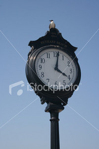 """<a href=""""http://www.istockphoto.com/file_closeup/object/2196148.php?id=2196148&refnum=jwilkinson"""" target=""""istock"""">seaside town clock</a><br>a old-fashioned town clock on a pole at the beach, with a seagull sitting on top"""