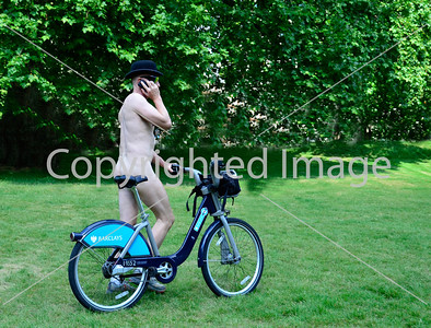 """Naked Ambition"" - a banker type makes a quick phone call to his stockbroker, before the Naked Bike Ride in Hyde Park, London!"