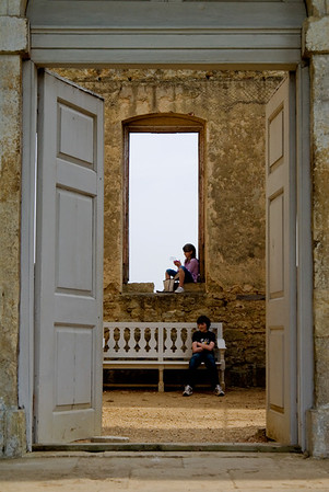 Photograph showing two children ignoring each other in the Temple of Friendship at Stowe.
