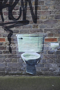 Toilet on a wall