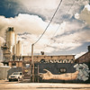 """<h2>Bushwick Street Art - Brooklyn - New York City</h2> - By Vivienne Gucwa  The sky wavered in mood earlier today displaying an angsty mix of rage-puffed storm clouds and baby blues streaked by sunlight. It was the perfect backdrop for Bushwick's incredible array of street art murals that pepper the industrial urban landscape.   I have been spending an inordinate amount of time in Brooklyn lately. My other half was born in Brooklyn (I like to refer to it as his """"hatch-zone"""") and is a great walking-off-steam companion. And so we keep ending up in interesting places on these walks.   Bushwick was never really a friendly place when I was younger (this is a severe understatement). It's fascinating to see the stage of evolution it seems to be in currently. The factories are all still there but there is also an amazing amount of art that seems to be thriving on the walls of Bushwick. Growing up in Queens ogling 5 Pointz, a large industrial space transformed into a premiere space for graffiti/street artists to cover in art, I was sad to hear that 5 Pointz will eventually be razed. However, Bushwick seems to have a blossoming 5 Pointz feel at this moment in time which is exhilarating to witness.   Who knows what the future holds for Bushwick? But, for now, it's a perfect mix of grit and art.  ----"""