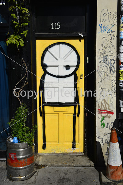 Stik art on a yellow door