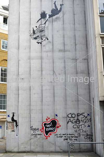 Falling Supermarket Trolley and Woman by Banksy