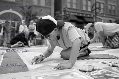 Chalk Festival downtown Denver.  I thought this was pretty cool a son helping his dad.