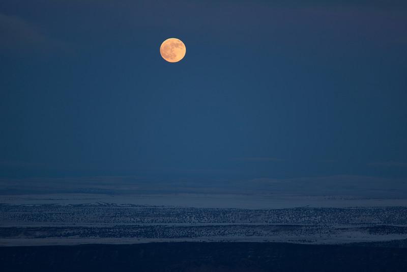 Moon bubble over desert