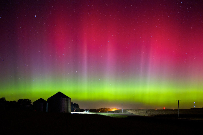 Colorful northern lights above a county road and grain bin in early October, shot in central Minnehaha County.