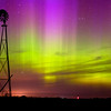 The northern lights with a prairie windmill on an early June night in Minnehaha County.