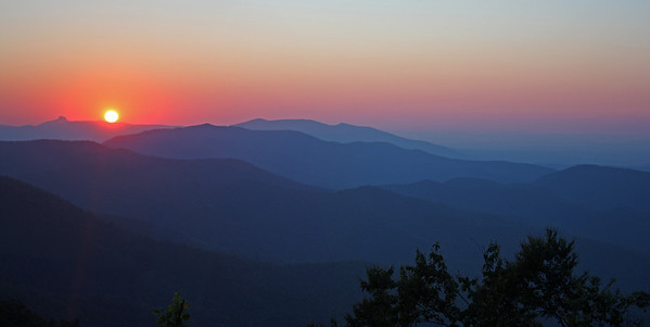 July sunrise from the Blue Ridge Parkway.  You can see Table Rock to the left on the horizon.