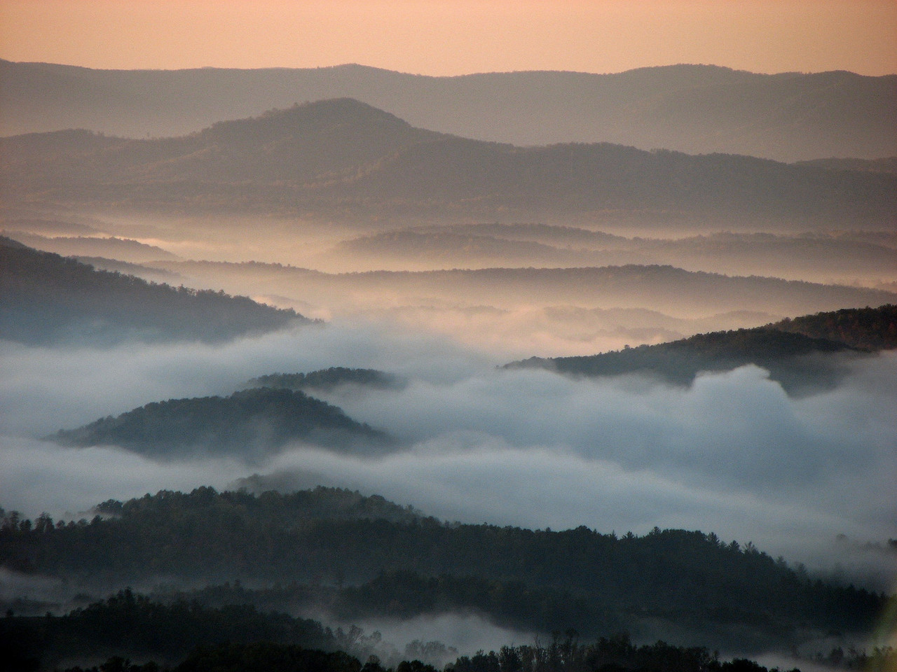 Low clouds and sunrise from Gillespie Gap, milepost 331 on the Blue Ridge Parkway