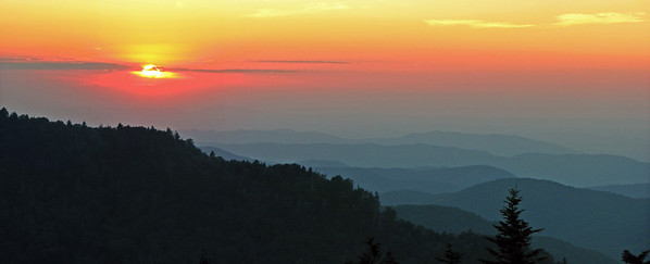 The sun sets behind the shoulder of Roan Mountain.  The ridges in Tennessee seem to go on forever