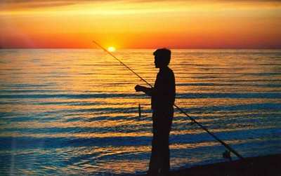 David bluefishing, sunset at Race Point, near Provincetown, CapeCod, Sept 1990