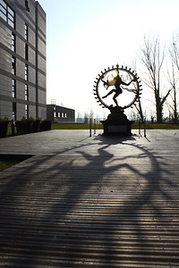 While at CERN, we befriended physicist Aiden Randle-Conde, who wrote the following piece about the relation between this dancing Shiva statue at CERN's headquarters and the particle physics research being done there: http://www.quantumdiaries.org/2011/11/10/in-the-shadow-of-shiva/  CERN headquarters. Meyrin, Switzerland. Photo by David Marks.