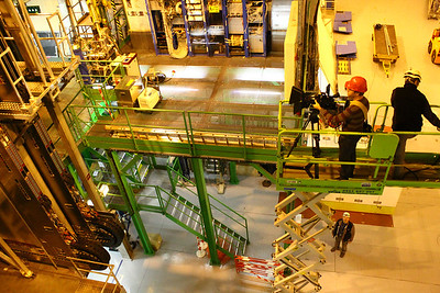 """Me filming crane shots inside the LHCb experiment, located in Ferney-Voltaire, France, which is creating and studying anti-matter to help us to understand why we live in a Universe that appears to be composed almost entirely of matter, but no antimatter. It's a fascinating coincidence that Voltaire lived here in the 18th century and wrote about """"possible worlds"""" without knowing the world's largest machine would be built directly under the soil he walked on to study related ideas.  Photo by David Marks."""